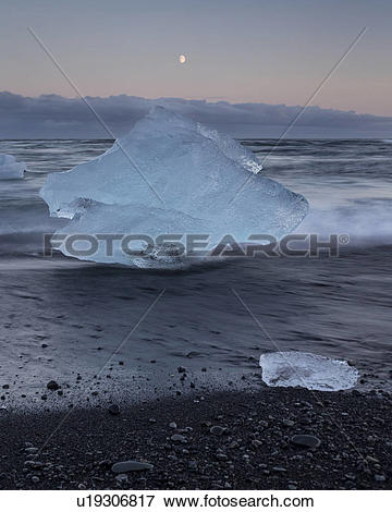 Picture of Icebergs at Jokulsarlon beach, sunset with moon rising.