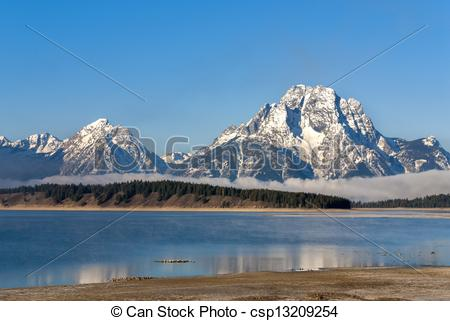 Stock Images of Tetons at Jackson Lake with snow.