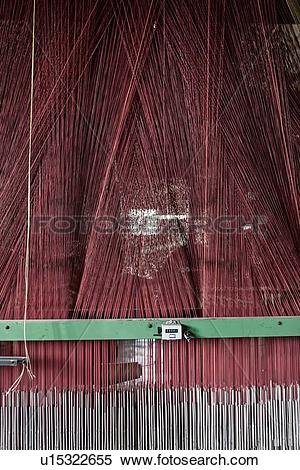 Stock Image of Close up view of Jacquard loom with pattern formed.