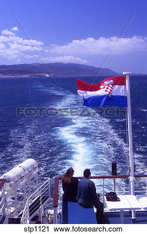 Stock Photography of Young couple on the top deck of the.