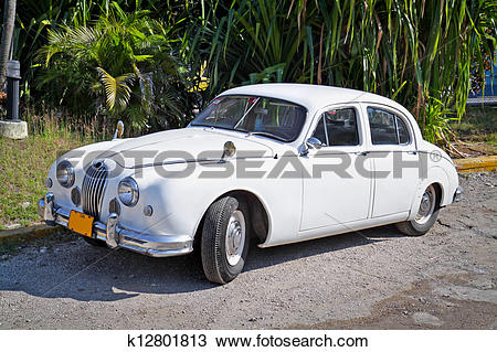 Stock Photo of Classic white Jaguar ,Havana. Cuba k12801813.