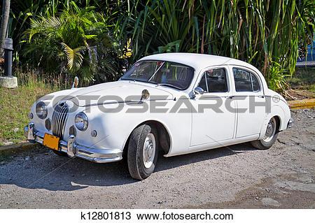 Stock Photo of Classic white Jaguar ,Havana. Cuba k12801813.