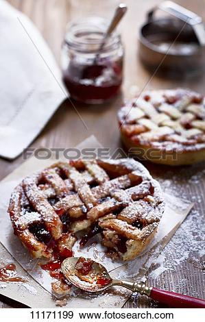 Stock Photograph of Individual shortcrust pastry tarts with plum.