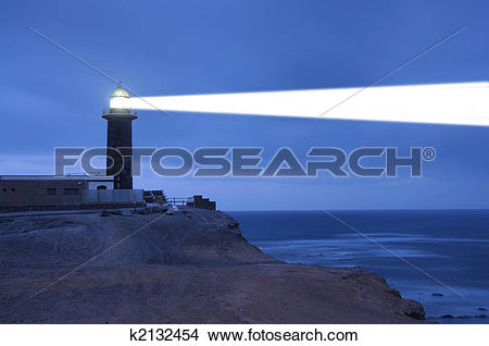Stock Photo of Lighthouse searchlight beam through foggy air.