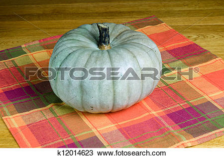 Stock Photo of Jarrahdale squash on a wooden table k12014623.