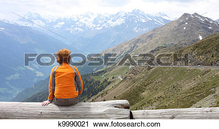 Stock Photography of girl looking at the mountains k9990021.
