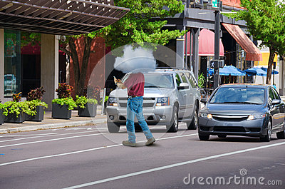 Jaywalking Man About To Be Run Over By Truck Royalty Free Stock.