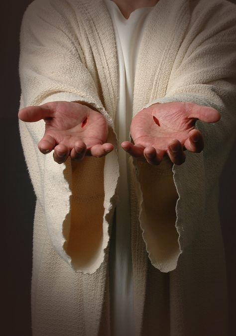Jesus\' nail scarred hands..