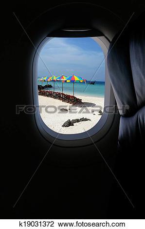 Stock Photo of Approaching island holiday destination, jet plane.