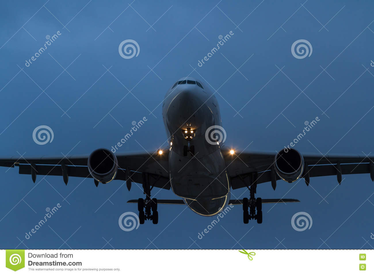 Commercial Jet Airliner In Flight At Night Stock Photo.