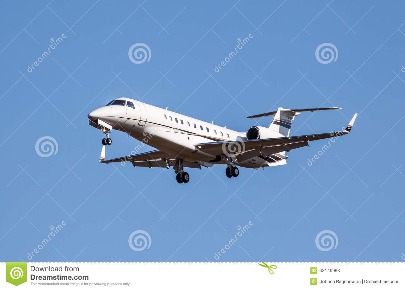 Private Jet Landing Stock Photo.