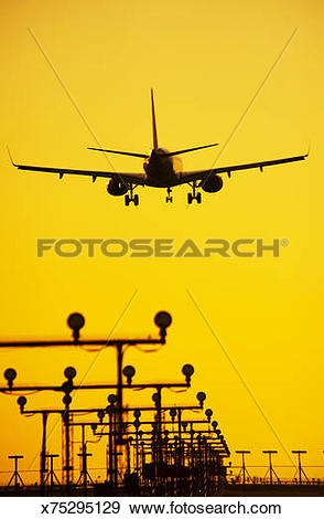 Stock Photograph of Commercial jet plane coming in for landing.