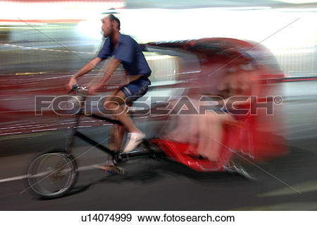 Stock Photograph of England, London, London, Bicycle rickshaw in.