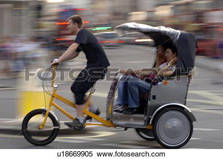 Stock Image of England, London, London, Bicycle rickshaw in London.