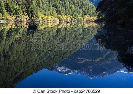 Stock Photo of reflection mountain on mirror lake at Jiuzhaigou.