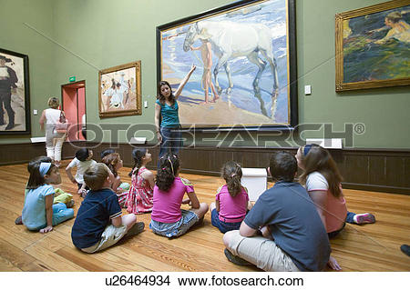 Stock Photo of Children have lesson on paintings by Joaquín.