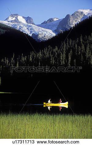 Stock Photo of yellow canoe on Joffre Lake near Pemberton, British.