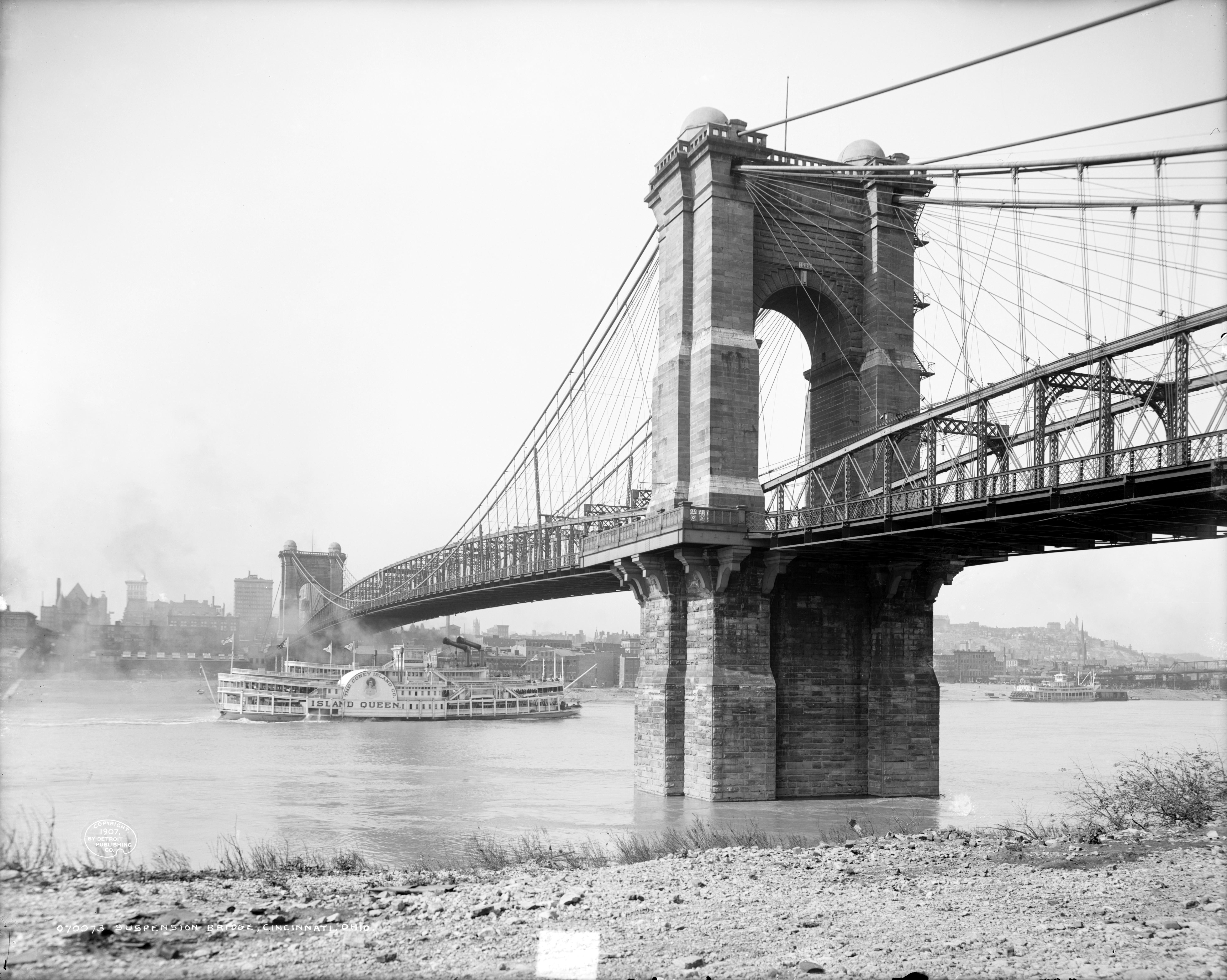 The John A. Roebling Suspension Bridge spans the Ohio River.