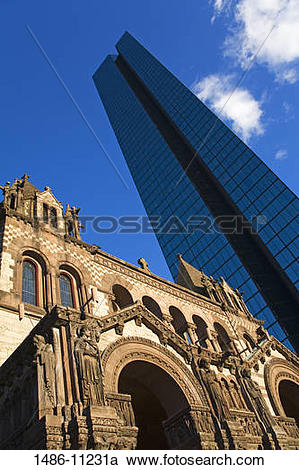 Stock Photography of Low angle view of a church near a tower.