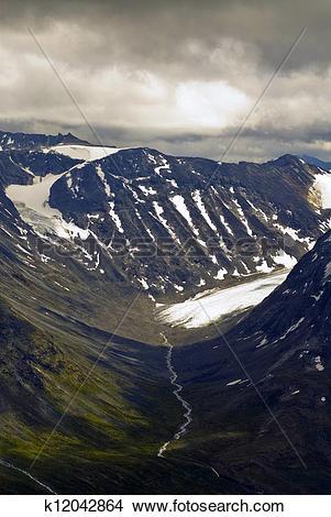 Stock Photo of Glacier and valleys in Jotunheimen k12042864.