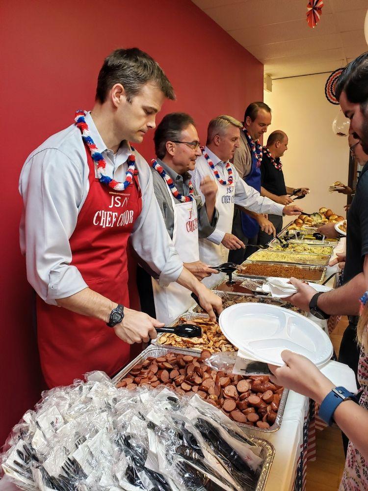 Leadership team serving food.