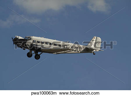 Stock Photo of German Junkers Ju 52 flying over Duxford, England.