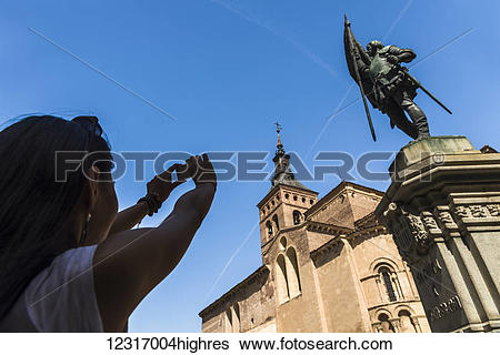 Stock Images of An asian young woman taking a picture of San.