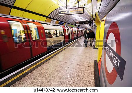 Stock Photo of England, London, Baker Street. Passengers walking.
