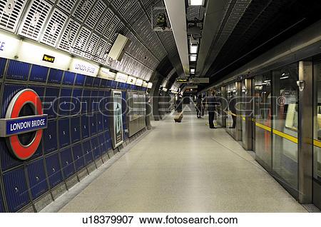 Picture of England, London, London Bridge. Passengers waiting to.