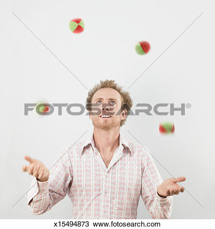 Stock Photo of Young man juggling balls x15494873.