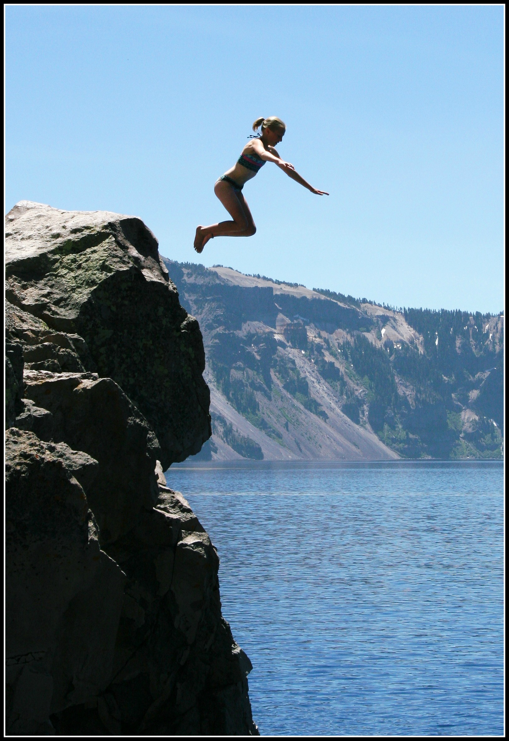 Man jumping off a cliff clipart.