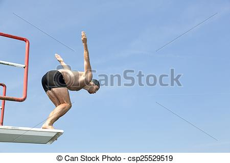 Man jumping off diving board at swimming pool.