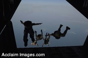 Clip Art of Pararescue Soldiers Jumping From a Plane.
