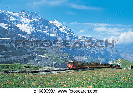 Picture of Passenger Train on a Track With Mt Jungfrau in the.