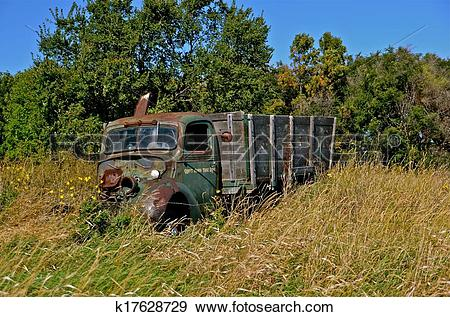 Stock Photograph of Junker Truck in the Weeds k17628729.