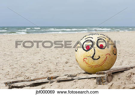 Stock Photograph of Denmark, Jutland, Lokken, painted buoy with.