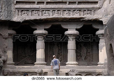 Stock Image of Tourist standing at entrance of cave no. 16.