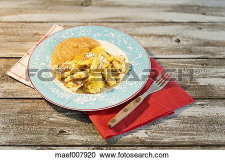 Stock Photography of Kaiserschmarrn pan cake with apple sauce.