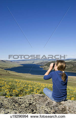 Stock Photo of A young girl enjoys the scene over Stump Lake, near.