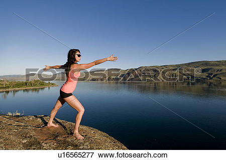 Picture of A young female practises the art of Yoga over Kamloops.