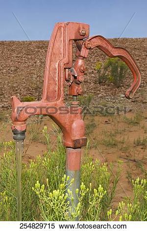Stock Image of Water running through a hand pump, Kanab, Utah, USA.