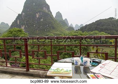 """Stock Photograph of """"Watercolor materials on a patio overlooking."""