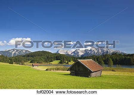 Stock Photo of Germany, Bavaria, Lake Geroldsee with haystack.