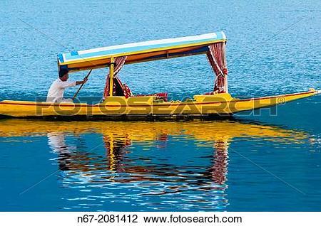 Stock Photo of A shikara (boat) on Dal Lake in Srinagar, Kashmir.