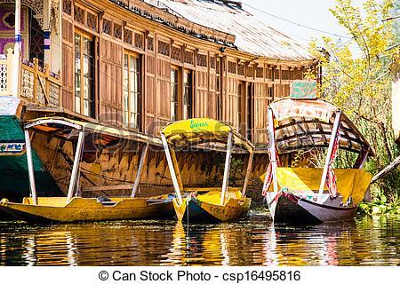 Stock Photography of Shikara boat in Dal lake , Kashmir India.