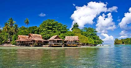 Holiday at Nusa Island Retreat. Scuba dive or surf in Kavieng, Papua.