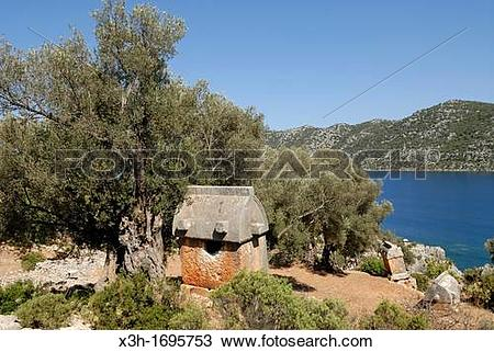 Stock Photo of ancient Lycian tombs in Kalekoy Simena, Kekova bay.
