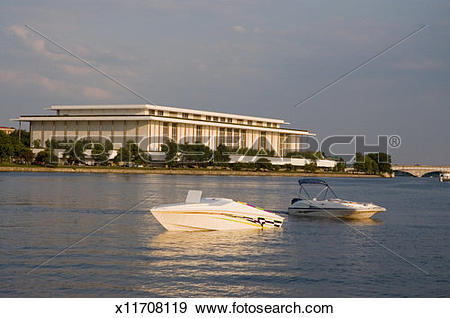 Stock Photograph of Two boats in front of a government building.