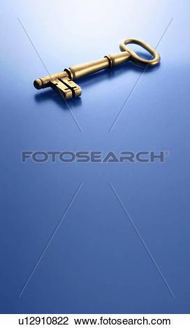Stock Photo of Close up of skeleton key on counter u12910822.