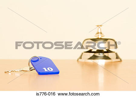 Stock Images of Key and counter bell at hotel is776.